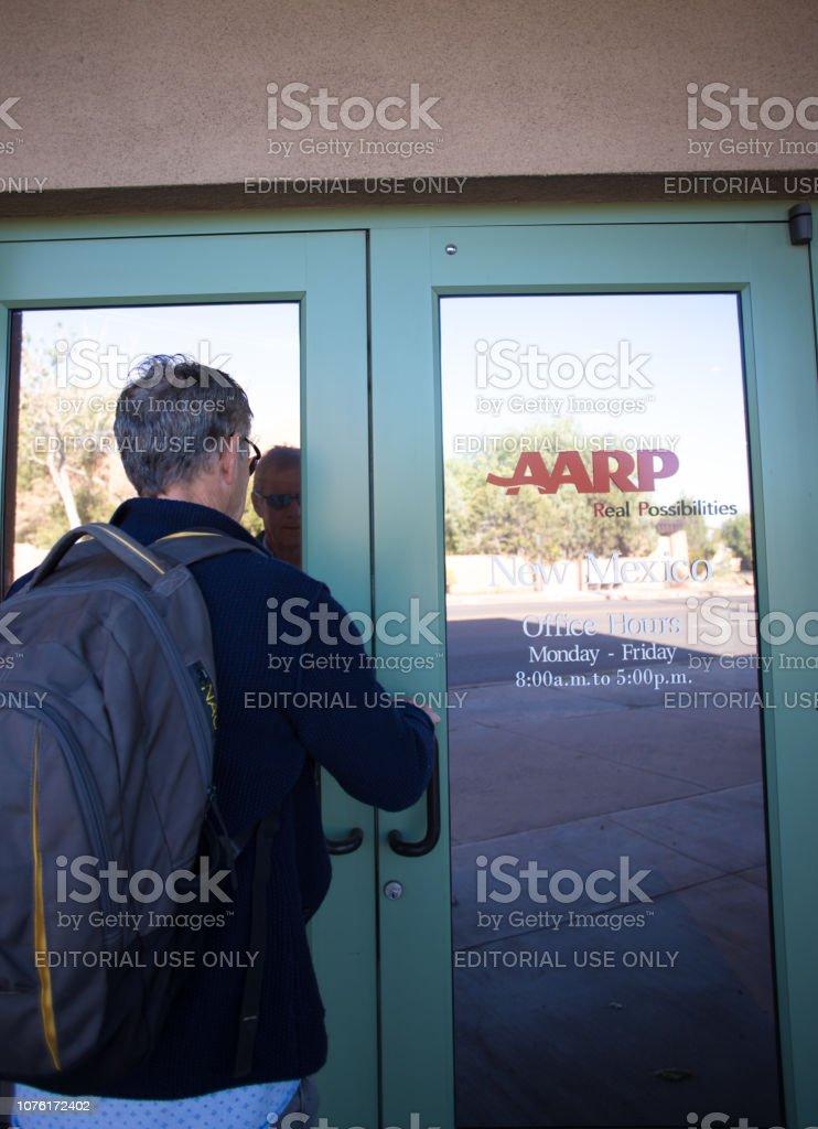 Santa Fe, NM: Man Entering AARP Office stock photo