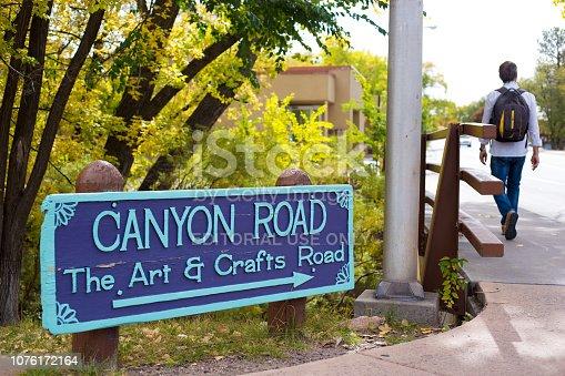 istock Santa Fe, NM: Man Walking Past Canyon Road Sign 1076172164