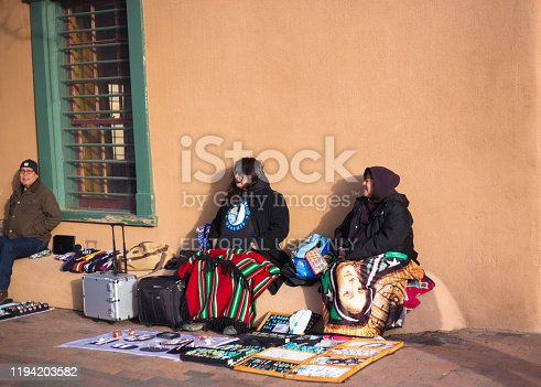 Santa Fe, NM: Native American vendors selling jewelry in front of the Palace of the Governors on the historic Santa Fe Plaza.