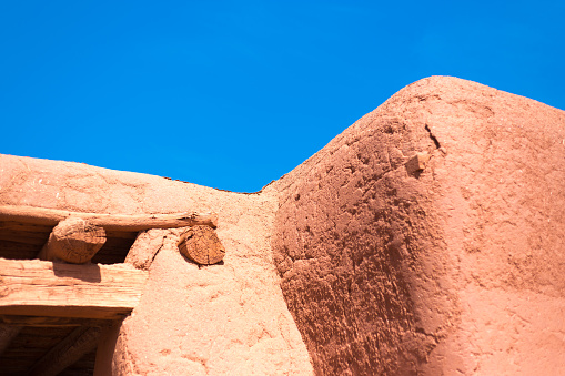 Santa Fe, NM: Old Adobe House Exterior Detail; Blue Background