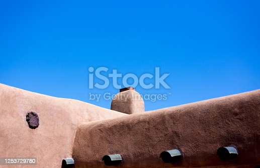 Santa Fe, NM: Old Adobe House Exterior Detail; Blue Sky background with copy space.