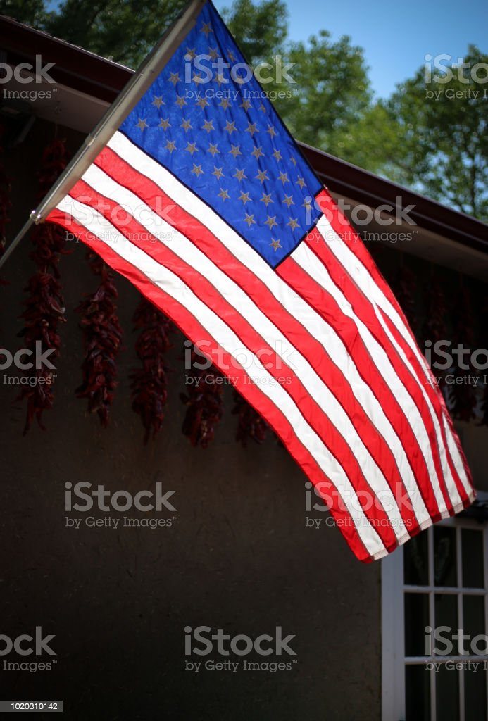 Santa Fe Nm Sunlit Us Flag Blowing Ristras In Background Stock Photo Download Image Now Istock