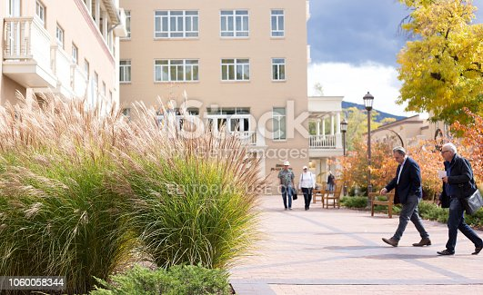 Santa Fe, NM: Tourists walking outside the Drury Plaza Hotel in downtown Santa Fe in autumn.