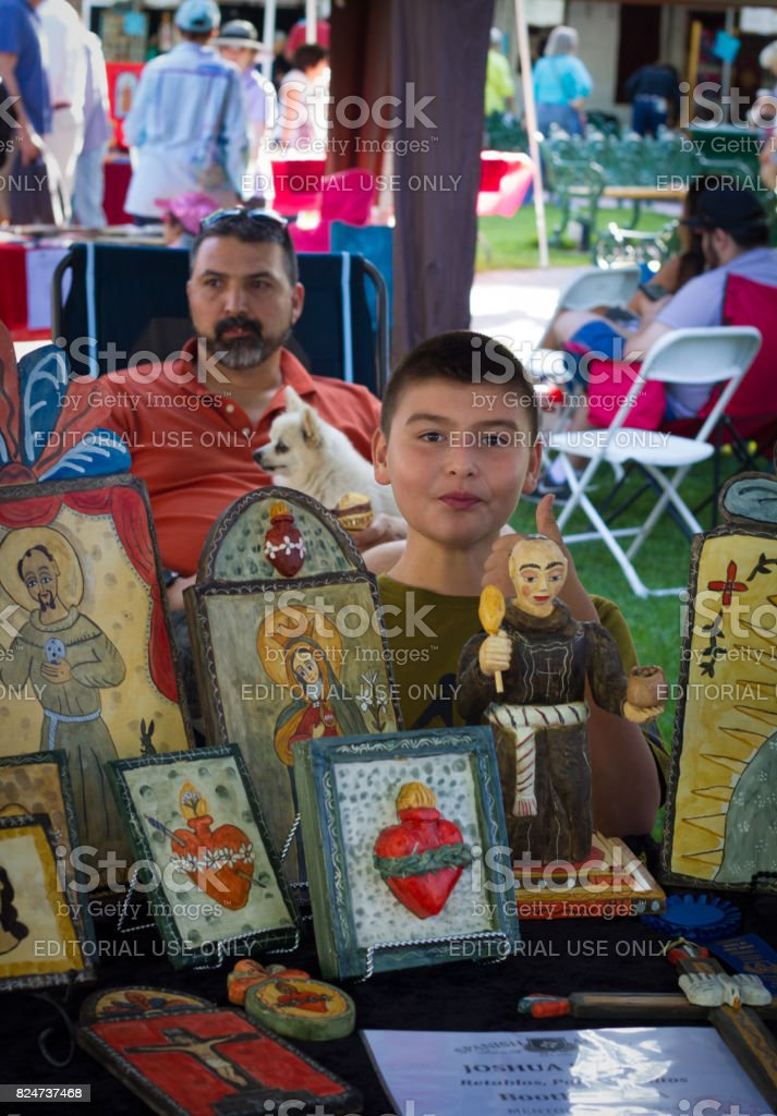 Santa Fe, NM: Youth Selling Retablos at 2017 Spanish Market stock photo