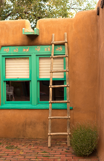 Santa Fe Style: Adobe Wall, Turquoise Window, Kiva Ladder