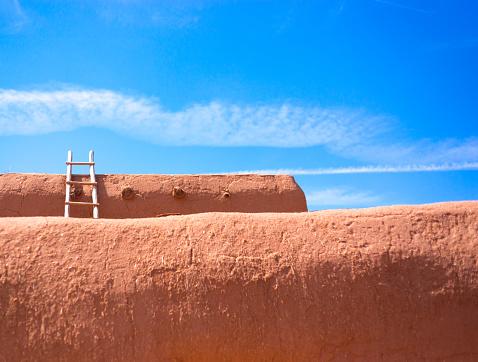 Santa Fe Style: Kiva Ladder Against Adobe Wall, Blue Sky