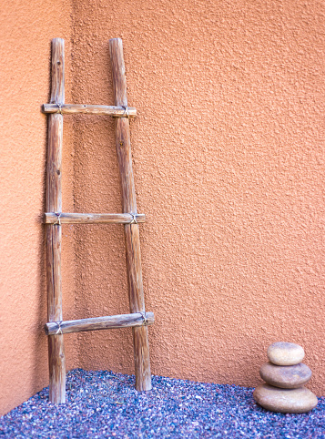 Santa Fe Style: Kiva Ladder Against Orange Adobe Wall