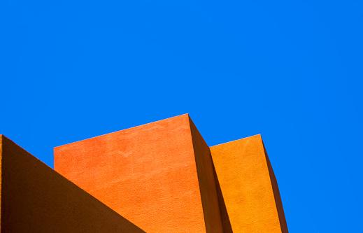 Santa Fe Style: Modern Adobe Building Exterior Detail, Blue Sky Background