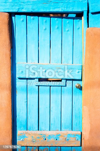 Santa Fe Style: Sunlit Turquoise Gate in Adobe Wall