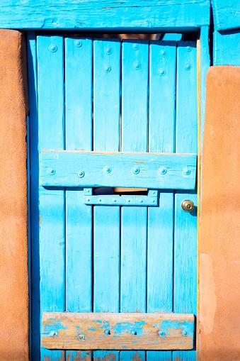 Santa Fe Style: Sunlit Turquoise Gate in Adobe Wall