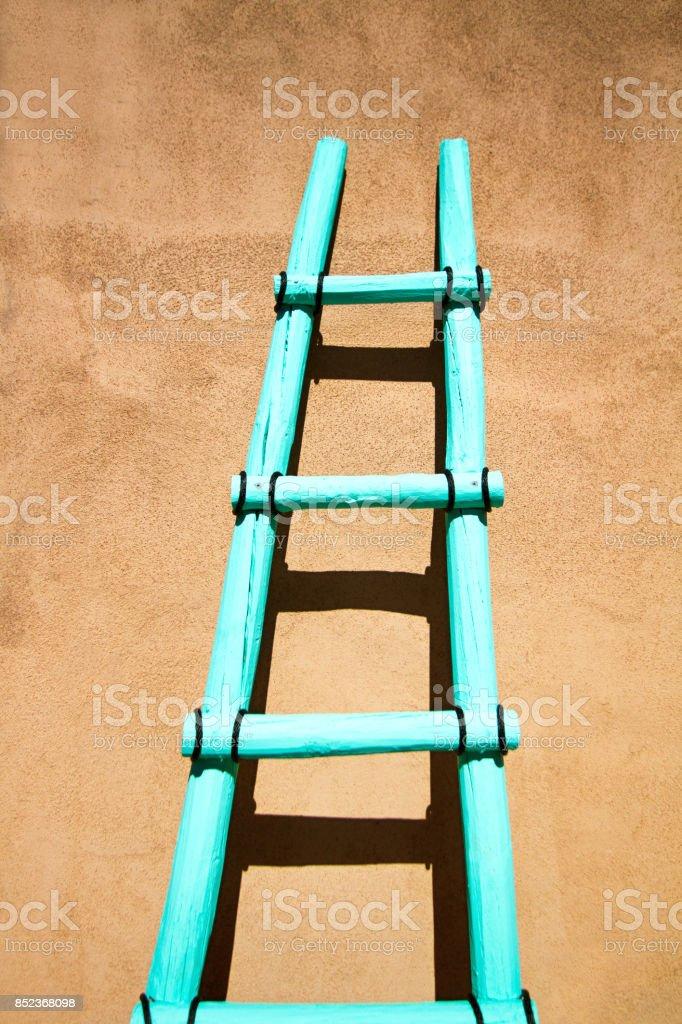 Santa Fe Style Turquoise Kiva Ladder Against Brown Adobe Wall Stock ...