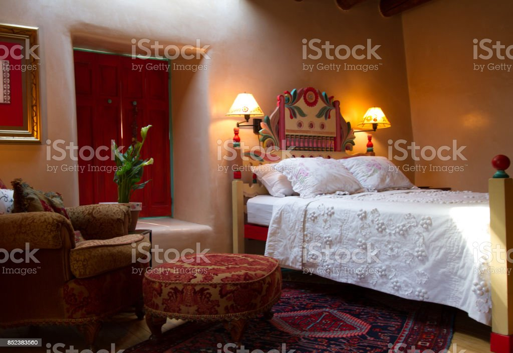 Santa Fe/Southwest Style: Colorful Bedroom with Adobe Walls