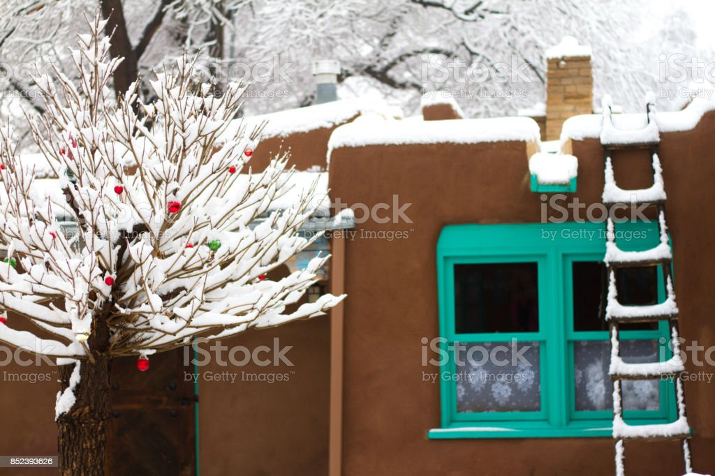 Santa Fe/Southwest Style: Old Adobe House in Snow stock photo