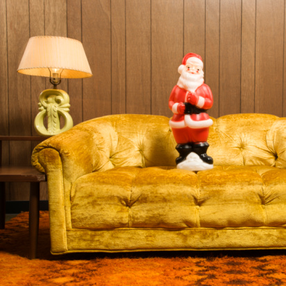 Santa clause figurine on retro style couch.