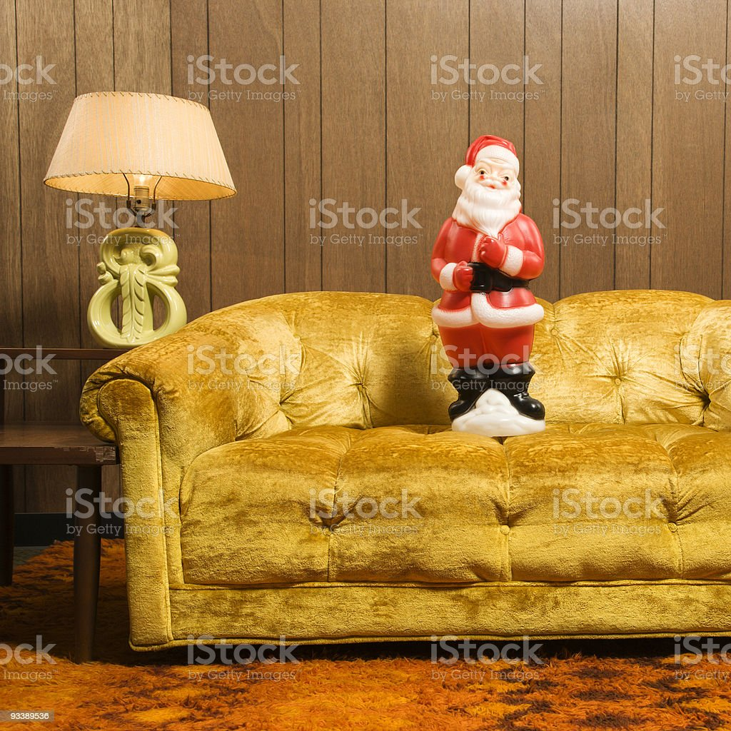 Santa figurine on couch. stock photo