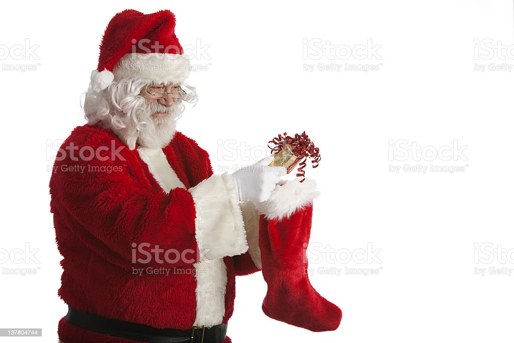 Santa Fills Stocking stock photo