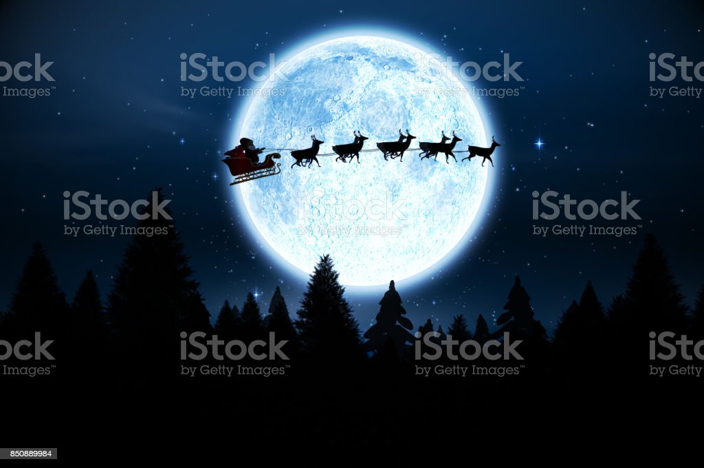 Santa flying over night sky - foto stock