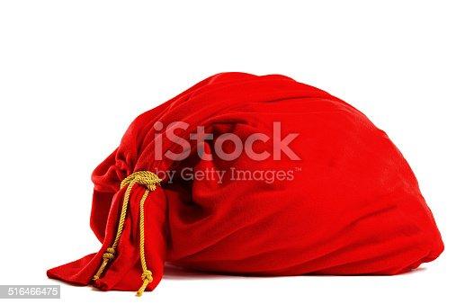 istock Santa gift bag Isolated on white background 516466475