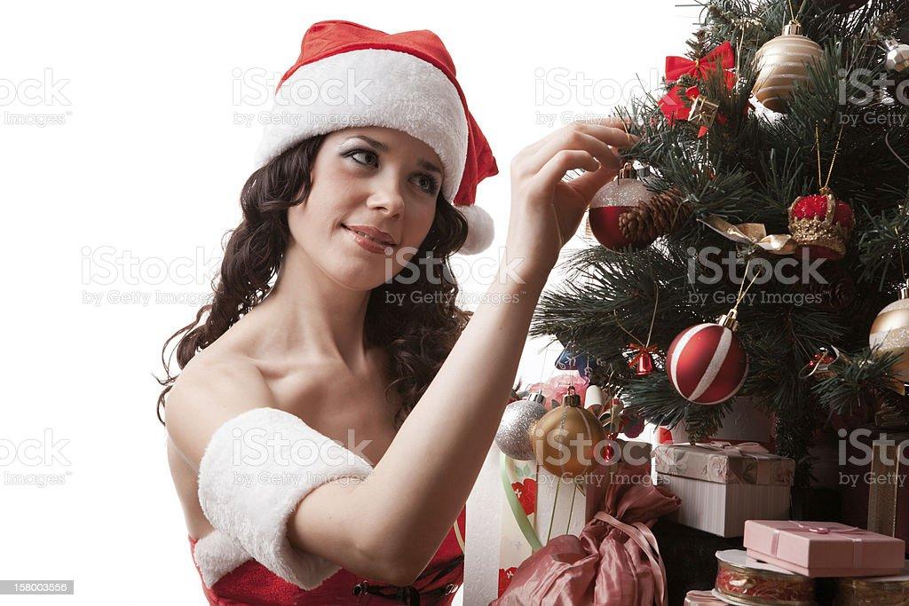 Santa girl decorates Christmas tree. royalty-free stock photo