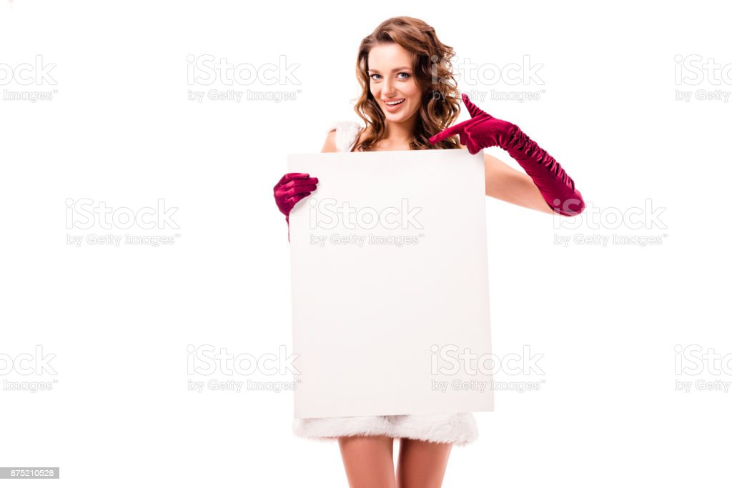 santa girl pointing at empty board stock photo
