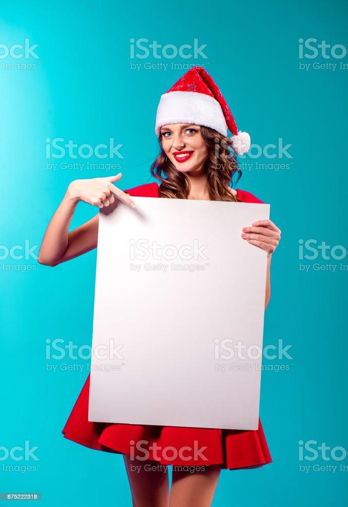 santa girl with blank card stock photo