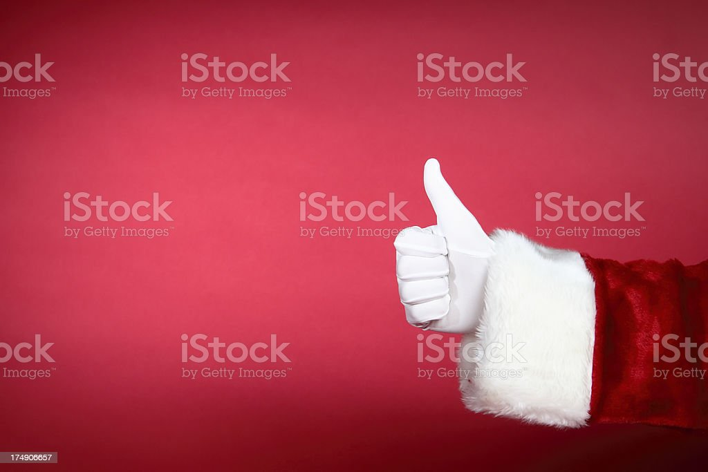 Santa Hands: Thumbs Up royalty-free stock photo
