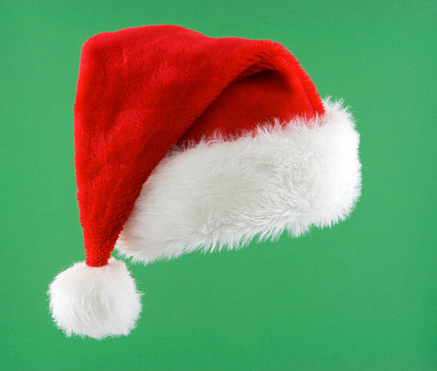Santa Hat Isolated Santa hat isolated on green. santa hat stock pictures, royalty-free photos & images