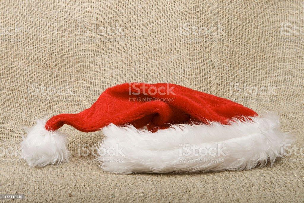 Santa hat on burlap background. royalty-free stock photo
