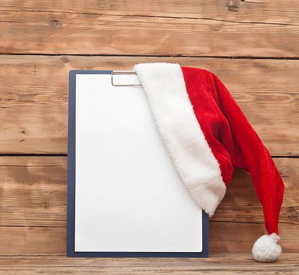 Santa hat on clipboard stock photo