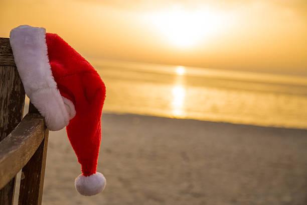 Santa hat on the beach stock photo