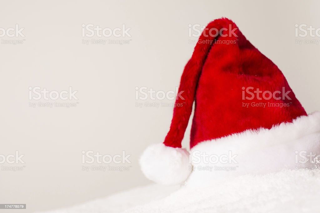 Santa Hat Sitting in the Snow, With Copy Space royalty-free stock photo