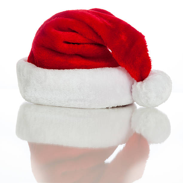 santa hat with reflection - carolinemaryan stock pictures, royalty-free photos & images