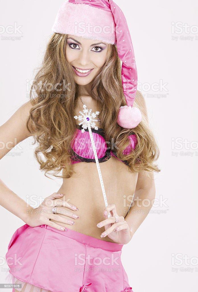 santa helper girl with magic wand royalty-free stock photo