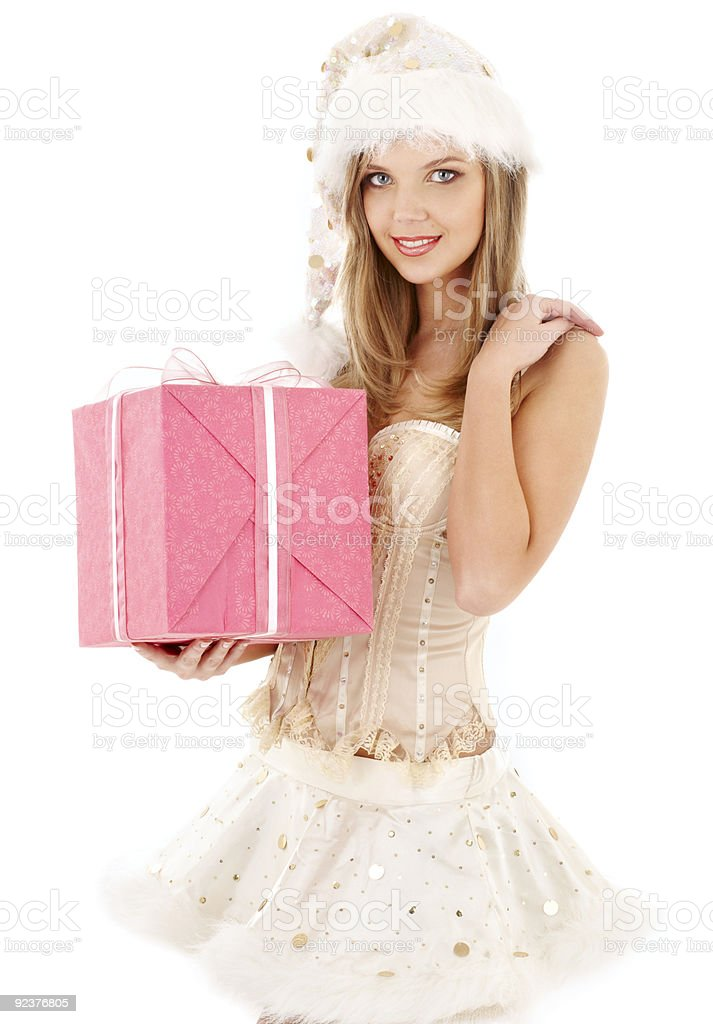 santa helper in corset and skirt with pink gift box royalty-free stock photo