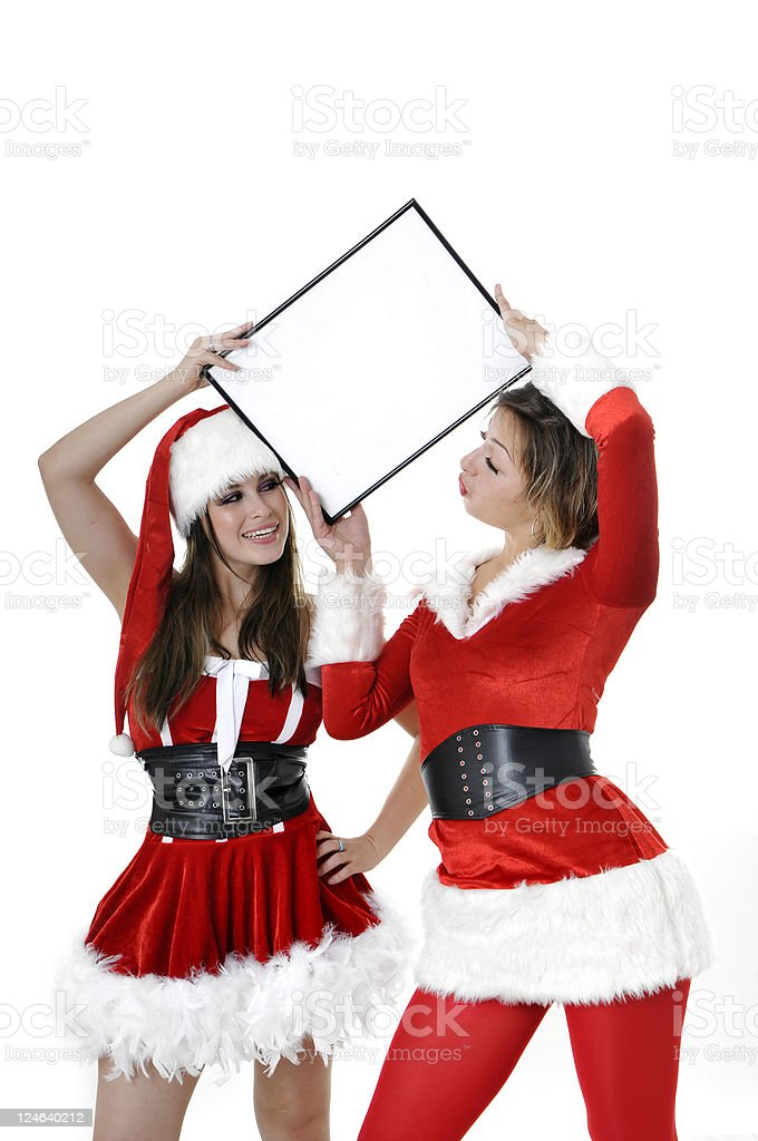 santa helpers with empty placard royalty-free stock photo