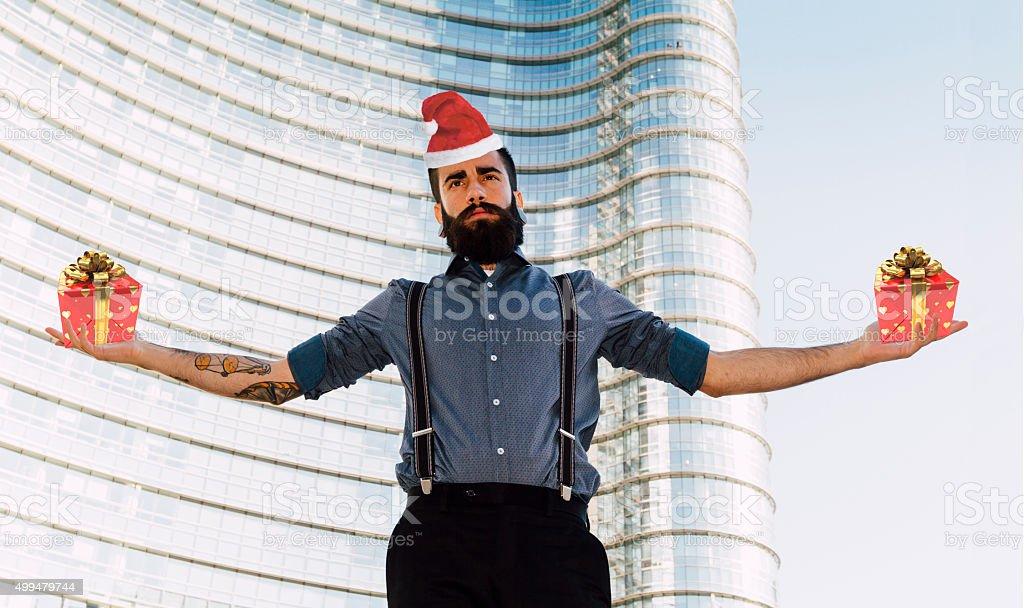 Santa Hipster holding gifts - Christmas stock photo