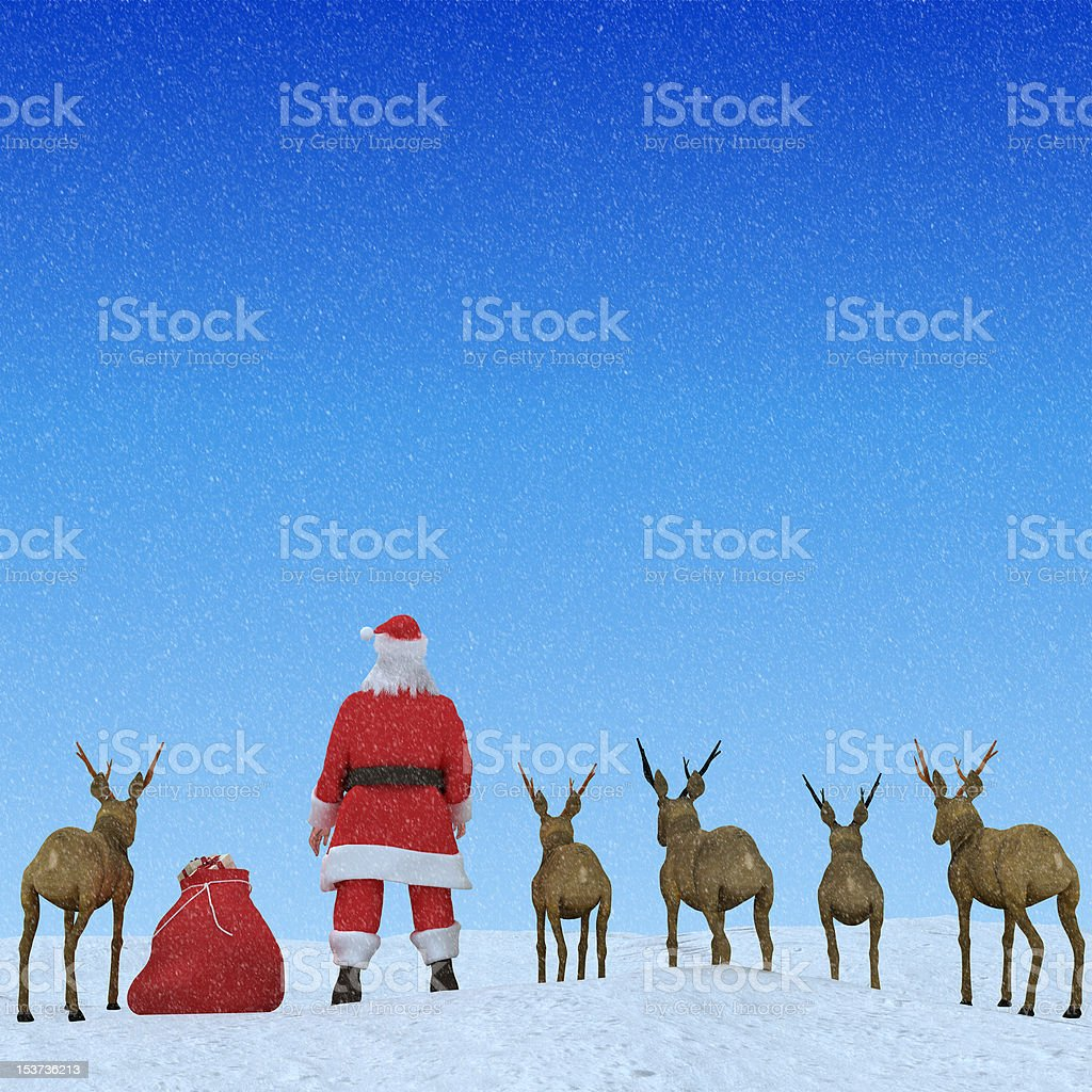 Santa & His Reindeers in the Snow at Christmas stock photo