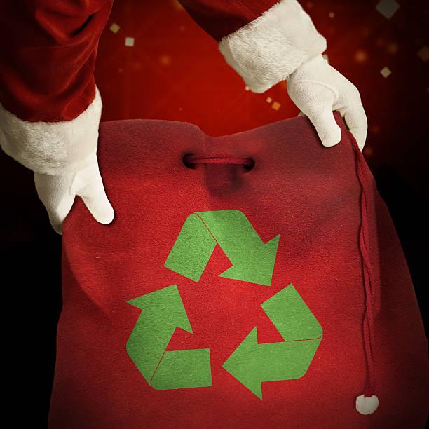 santa hold recycle bag stock photo