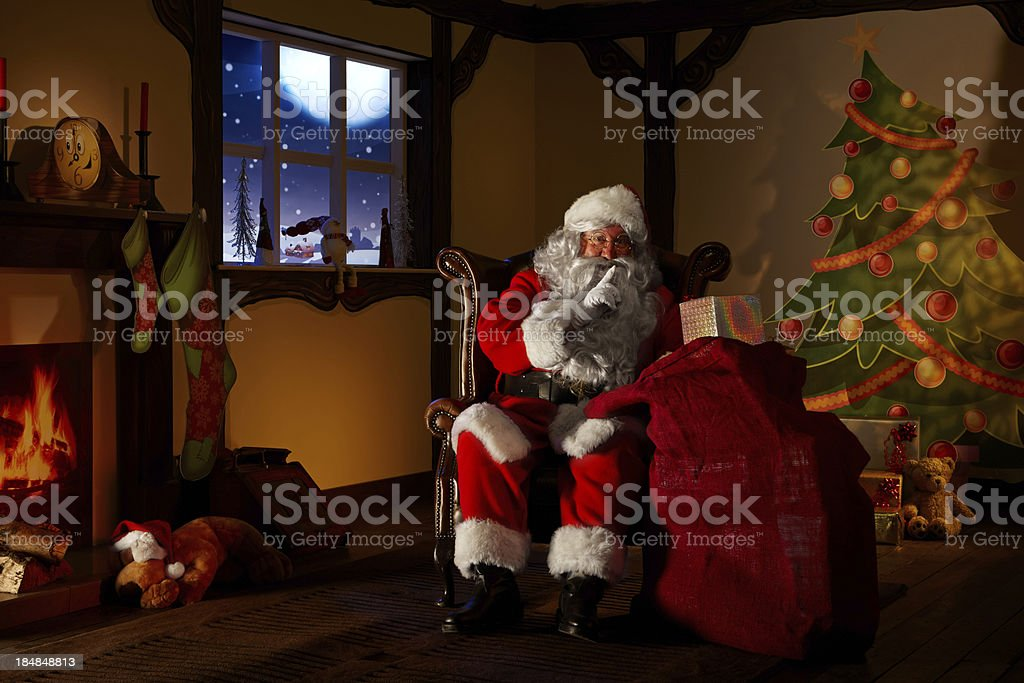 Santa holding a bag full ofchristmas gifts stock photo