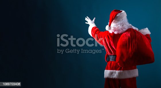 istock Santa holding a red sack 1069703408