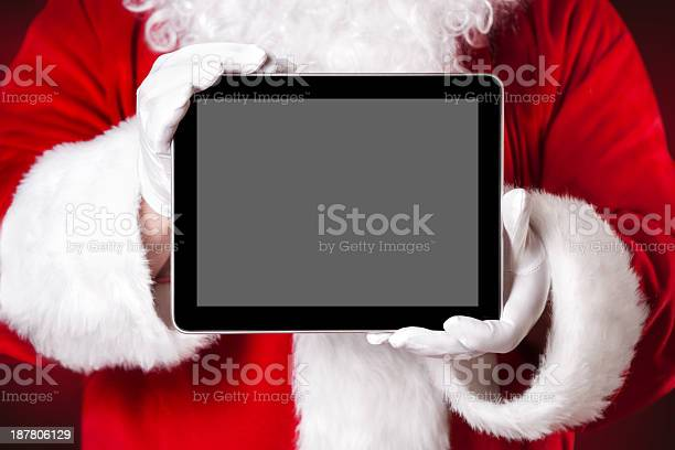 Santa Holding A Tablet With Blank Space Stock Photo - Download Image Now