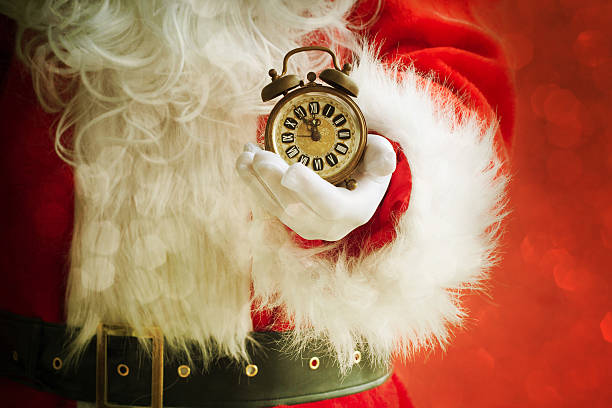 santa holding alarm - countdown stock photos and pictures