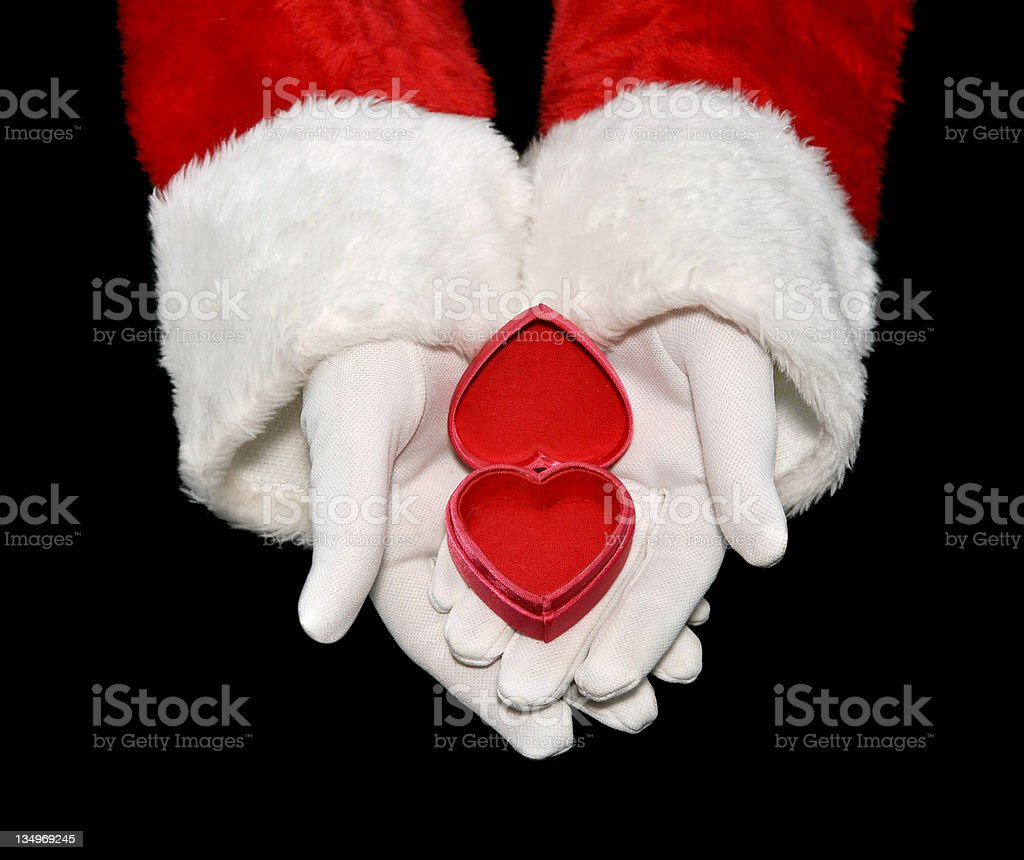 Santa Holds An Opened Heart-shaped Box royalty-free stock photo