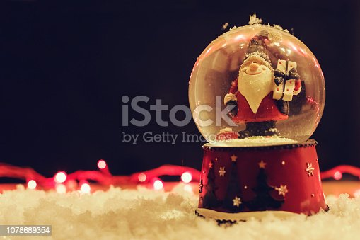 istock Santa In a Snow Globe Decoration Background 1078689354