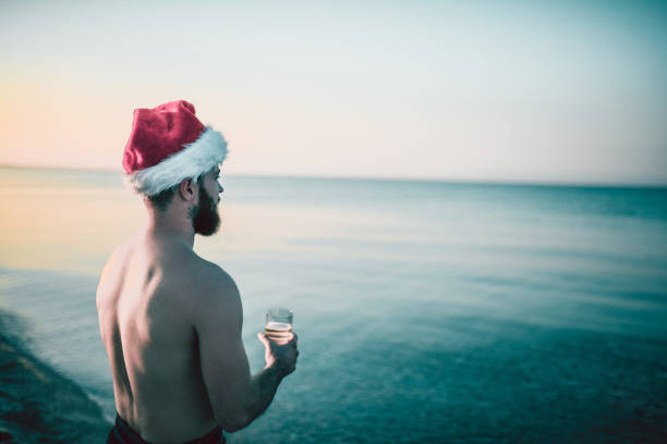 santa is staring at the ocean tranquility - naked santa claus stock pictures, royalty-free photos & images