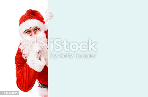 istock Santa keeps Christmas secrets 860614022