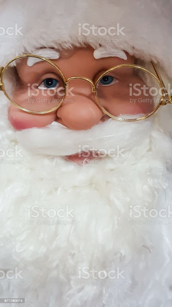 Santa Klaus face wearing gold rimmed spectacles stock photo