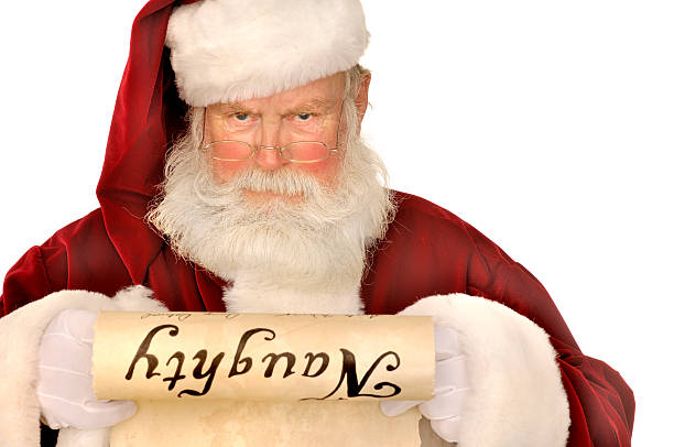 santa looking at naughty list stock photo