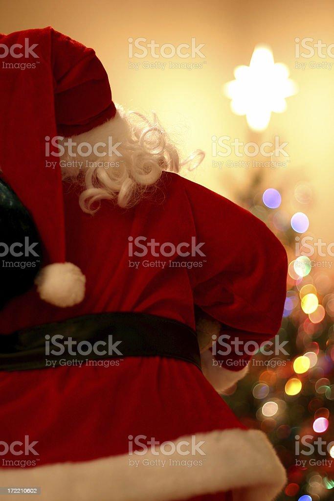 Santa looking at Tree royalty-free stock photo