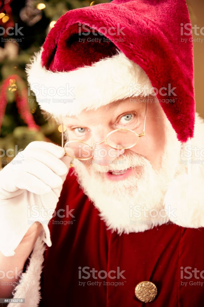 Santa Looking Over The Top of His Wire Rimmed Glasses At The Viewer stock photo